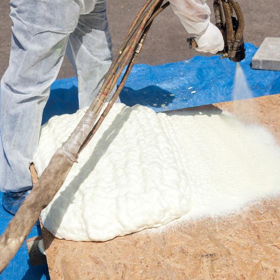 A Man Applying Spray Foam Roofing.