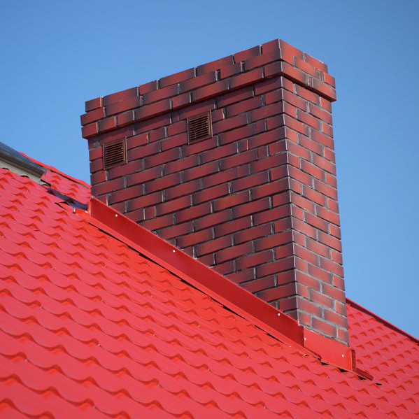 A Chimney with Red Roof Flashing.