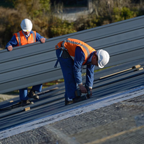 Roofers Install a Commercial Roof
