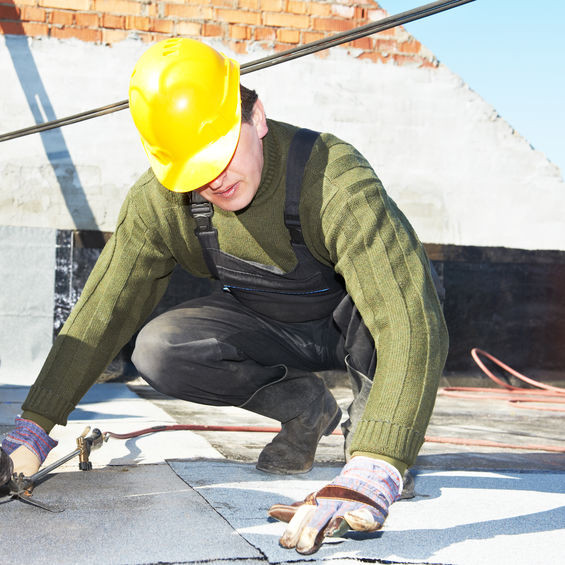 A Roofer Making an Inspection.