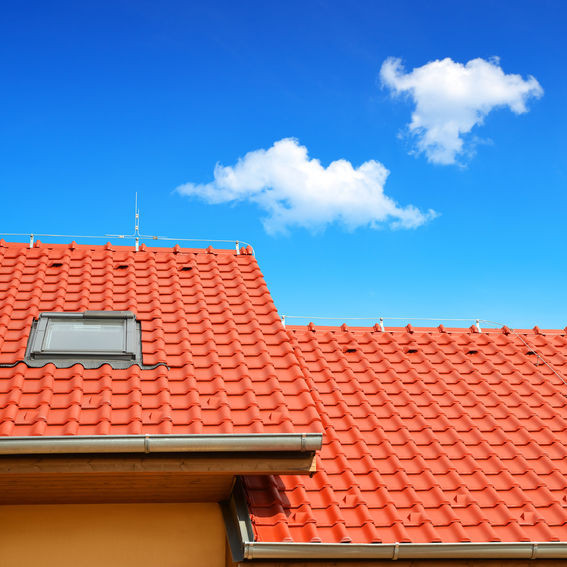 A Roof With Red Tiles.