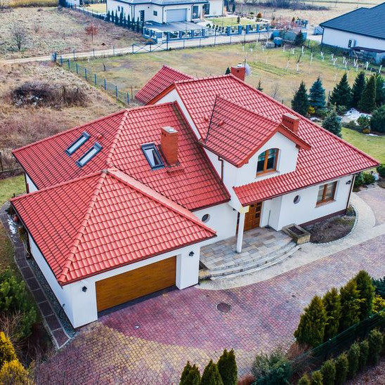 An Aerial View of a Red Tile Roof.