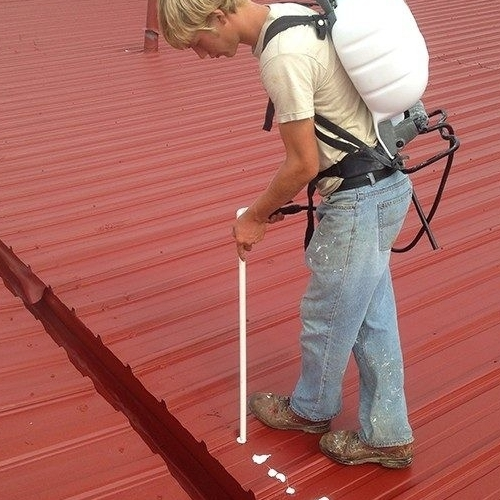 A Roofer Works on a Metal Roof.