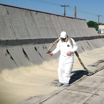 A Roofer Sprays Foam Roofing.