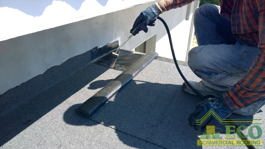 Roofer Preparing Bitumen Roofing Felt