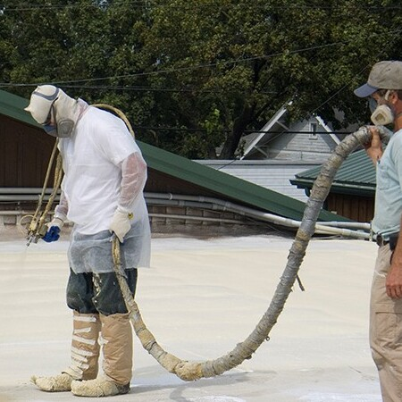 A Roofer Uses Spray Foam.