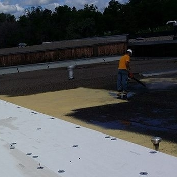 A Roofer Adds a Silicone Roof Coating.